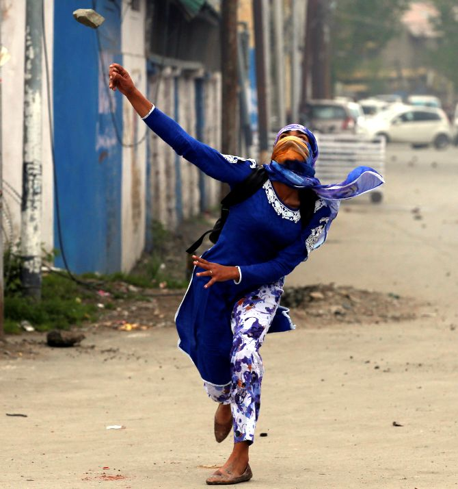 A youth hurls a stone at security forces in the Kashmir valley. Photograph: Danish Ismail/Reuters