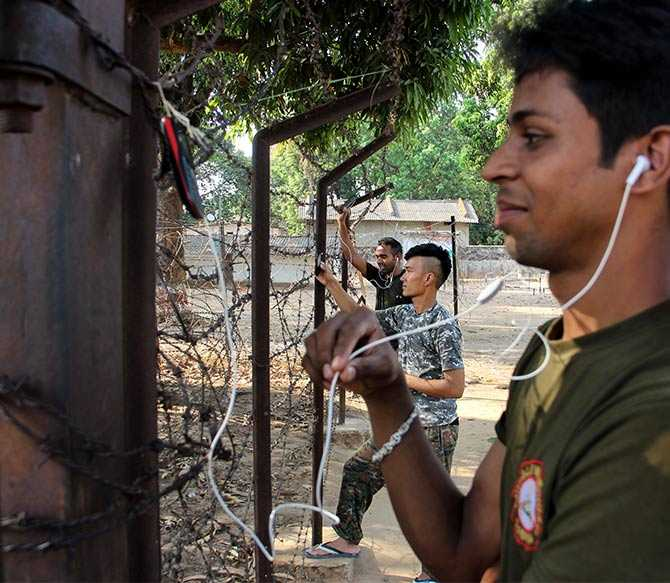When Rediff.com's Prasanna D Zore and Uttam Ghosh visited Gangaloor camp in Bijapur district on May 6, they discovered jawans of the CoBRA (Combat Battalion for Resistive Action, a specially trained force of the CRPF) battalion hooked onto their mobile phones along the gates of the Gangaloor police station. The jawans said it was the only location around the entire CRPF camp that had some network connectivity.