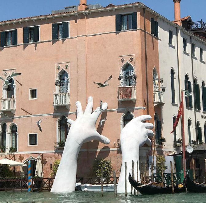 India News - Latest World & Political News - Current News Headlines in India - PHOTOS: Why giant hands are emerging from the water in Venice