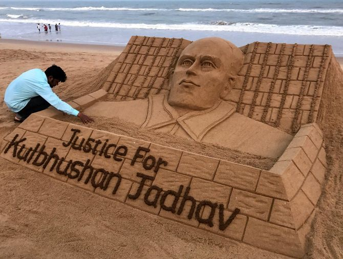 Sand artist Sudarsan Patnaik creates a sand sculpture for Kulbhushan Jadhav at the Puri beach in Odisha. Photograph: PTI Photo
