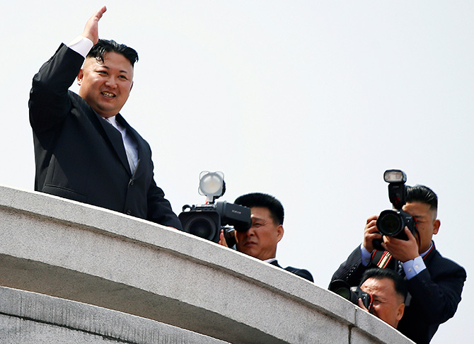 North Korean leader Kim Jong-un waves to people attending a military parade marking the 105th birth anniversary of the country's founder Kim Il-sung, in Pyongyang, April 15, 2017. Photograph: Damir Sagolj/Reuters