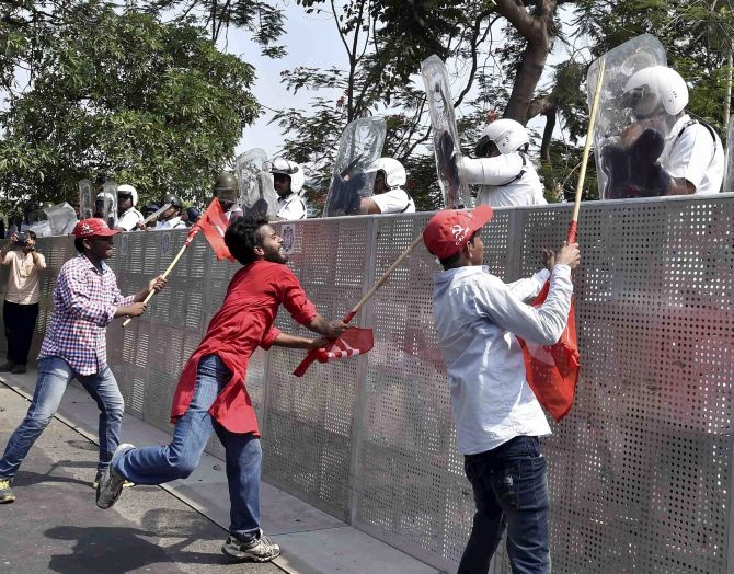 India News - Latest World & Political News - Current News Headlines in India - 100 Left workers, 79 cops injured in clashes during protest march