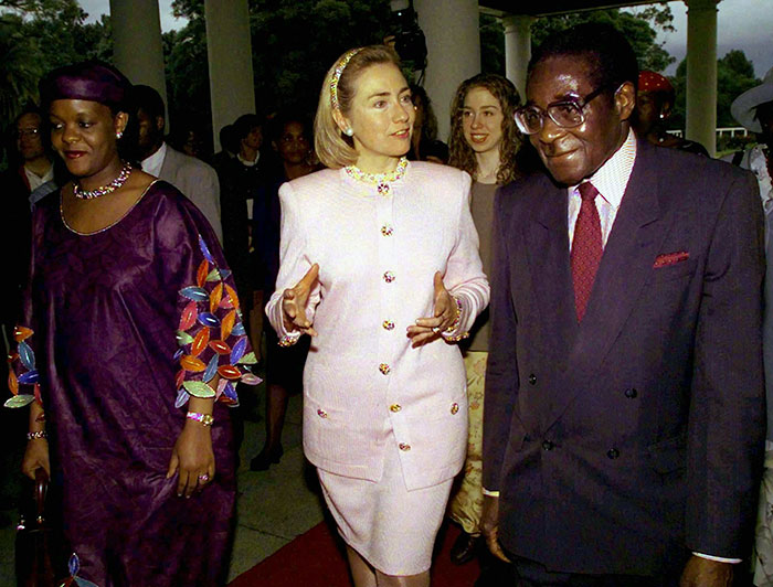 Hillary and Chelsea Clinton with Robert and Grace Mugabe
