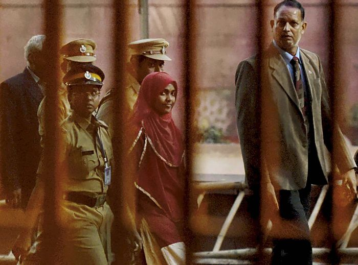 Akhila Ashokan aka Hadiya accompanied by police officers and court officials. Photograph: PTI