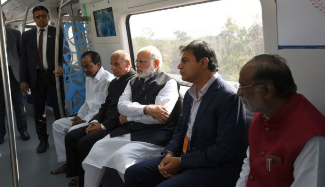 Prime Minister Narendra D Modi with to his right Telangana Governor E S L Narasimhan and Chief Minister K Chandrashekhar Rao at the inauguration of the Hyderabad Metro, November 28. Photograph: PIB_India/Twitter