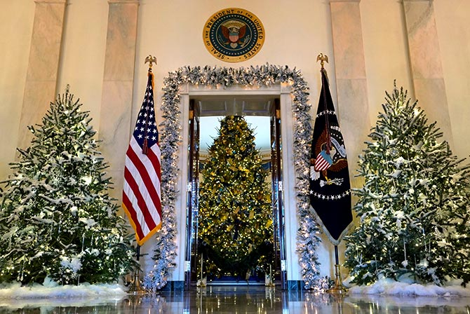 the official white house christmas tree is seen from the cross hall of the white house in washington the blue rooms christmas tree stands at 18 feet