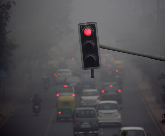 Visibility is just 200 metres on this Delhi road. Photograph: Cathal McNaughton/Reuters