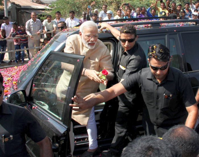 Prime Minister Narendra D Modi during a roadshow in Vadnagar, Gujarat, October 8, 2017. Photograph: PTI Photo