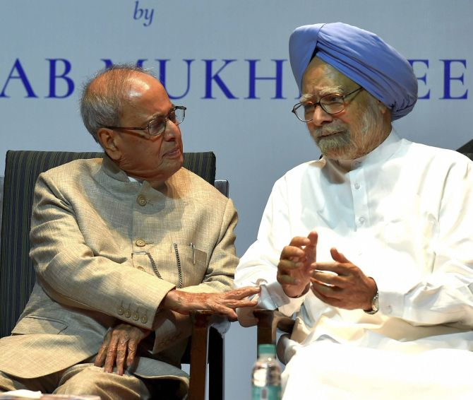 Former President Pranab Mukherjee with former prime minister Manmohan Singh at the book release function in New Delhi, October 13, 2017. Photograph: Atul Yadav/PTI Photo