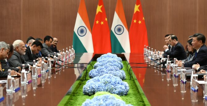 Prime Minister Narendra D Modi and his delegation meets with Chinese President Xi Jinping and his team on the sidelines of the 9th BRICS Summit in Xiamen, China, September 5, 2017. Photograph: Press Information Bureau