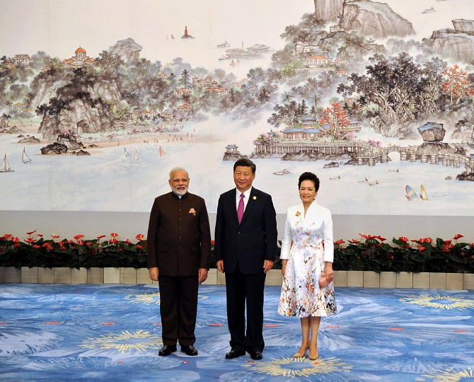 Prime Minister Narendra D Modi with Chinese President Xi Jinping and his wife Peng Liyuan at the welcome banquet for BRICS leaders in Xiamen, China, September 4, 2017. Photograph: Press Information Bureau