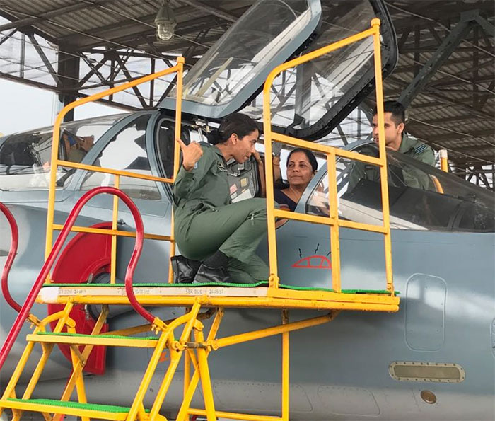 Squadron Leader Vidhu and Flight Lieutenant Kishan explain to Defence Minister Nirmala Sitharaman the working of the cockpit of a Mirage fighter at the Indian Air Force Station in Gwalior. Photograph: Kind courtesy @nsitharaman/Twitter