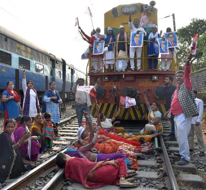 Activists stop a train at the Rajendra Nagar Terminal during the Bharat Bandh against the dilution of the Scheduled Caste/Scheduled Tribe Act in Patna. Photograph: PTI Photo