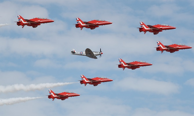 The Red Arrows, the Royal Air Force Aerobatic Team, are joined by a Spitfire at the opening of the Farnborough Airshow, in Farnborough, July 16, 2018. Photograph: Peter Nicholls/Reuters