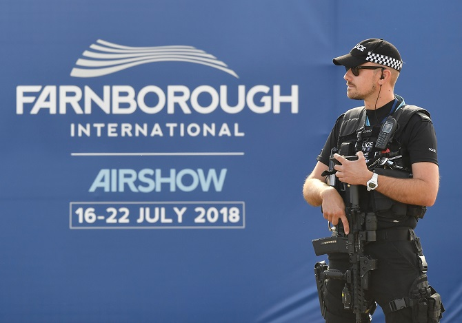 An armed police officer stands guard at the Farnborough  Airshow, July 17, 2018. Photograph: Toby Melville/Reuters