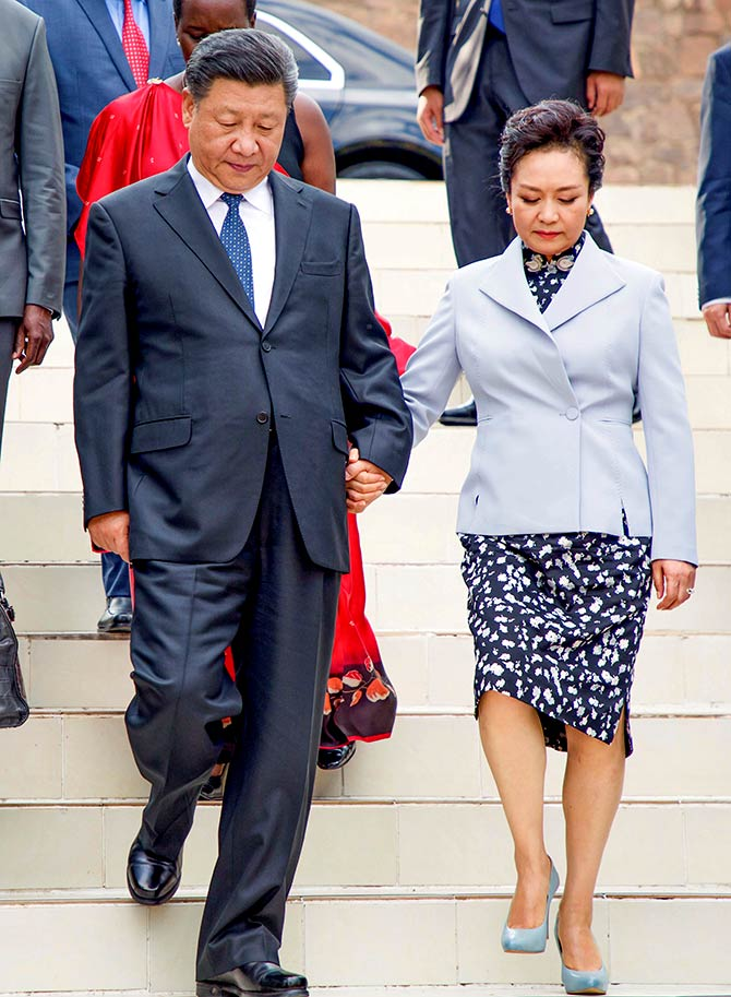Xi Jinping and his wife Peng Liyuan arrive at the Kigali Genocide Memorial during his visit to Kigali, Rwanda, July 23, 2018. Photograph: Jean Bizimana/Reuters
