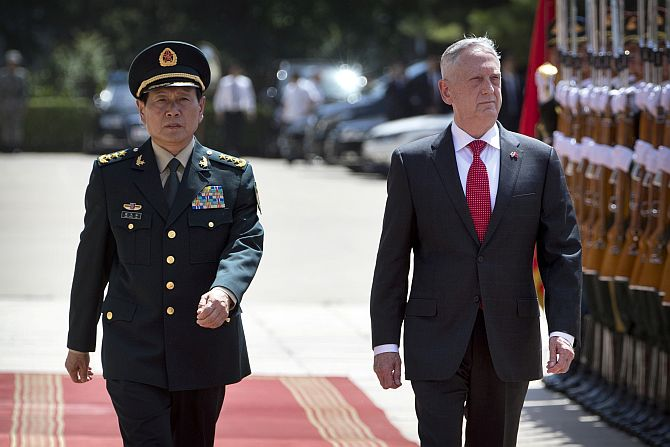 China's Defence Minister Wei Fenghe and United States Defense Secretary General Jim Mattis review an honour guard in Beijing, June 27, 2018. Photograph: Mark Schiefelbein/Reuters
