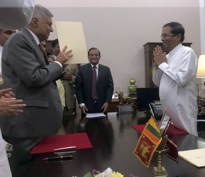 Sri Lankan president reinstates Wickremesinghe as PM