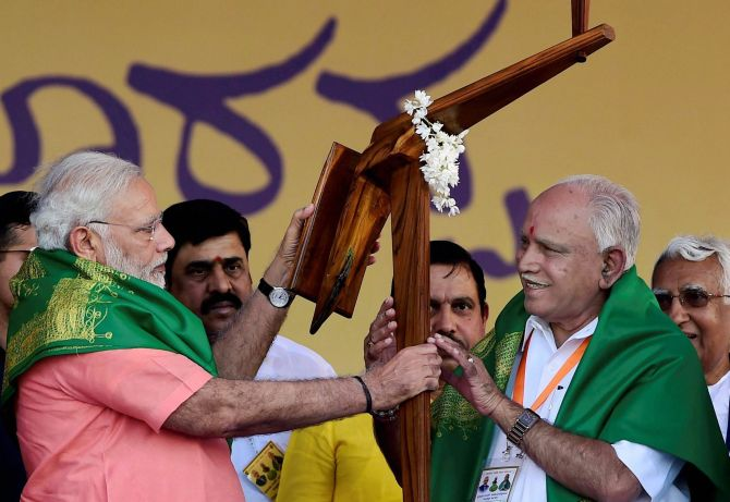 Prime Minister Narendra D Modi, left, on the campiagn trail in Karnataka