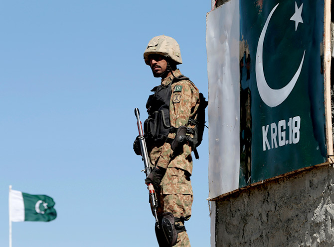 A Pakistan soldier stands guard at the Angoor Adda outpost along the border with Afghanistan in South Waziristan, Pakistan, October 18, 2017. Photograph: Caren Firouz/Reuters
