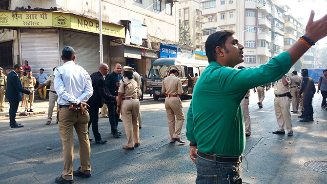 Israeli security personnel congratulate the Mumbai lady police officer who was in charge of security arrangements at the area after the Netanyahu visit had passed without incident. Photograph: Vaihayasi Pande Daniel/Rediff.com