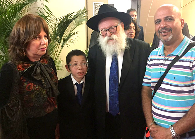 Moshe with his maternal grandparents Yehudit Rosenberg, Rabbi Shimon Rosenberg and Dr Kuresh Zorabi. Dr Zorabi, once a neighbour of the Holtzbergs, also attended the memorial service held for Moshe's parents Rabbi Rivka and Gavriel Holtzberg. Dr Zorabi ran an eye clinic around the corner from Chabad House. His family owns the 24x7 Rex Bakery, exactly opposite Chabad House. The bakery was peppered by terrorist bullets and the staff barely escaped with their lives by hiding in the backrooms. The bullet marks are still evident on the wall of the bakery.  Photograph: Kind courtesy Dr Kuresh Zorabi