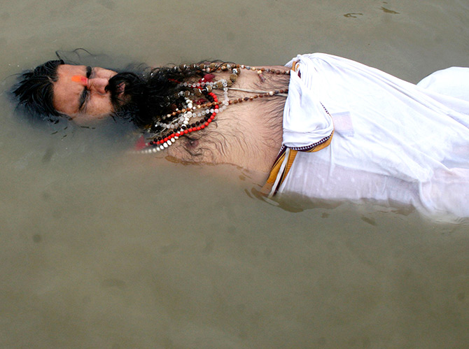 A sadhu takes a dip in the Ganga