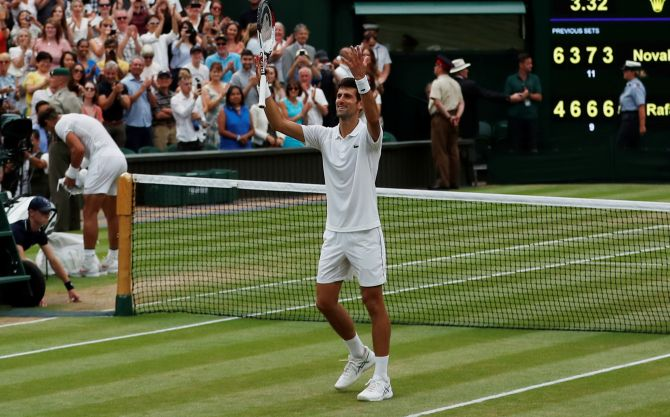 Rediff Sports - Cricket, Indian hockey, Tennis, Football, Chess, Golf - PHOTOS: Djokovic outlasts Nadal in classic Wimbledon semi-final