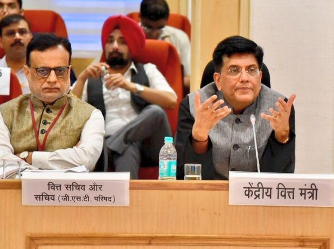 No GST on sanitary pads, rakhis; rates slashed on shoes