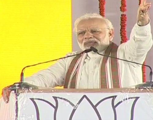 PM slams Oppn, refers to Rahul's 'unwanted hug' at UP rally