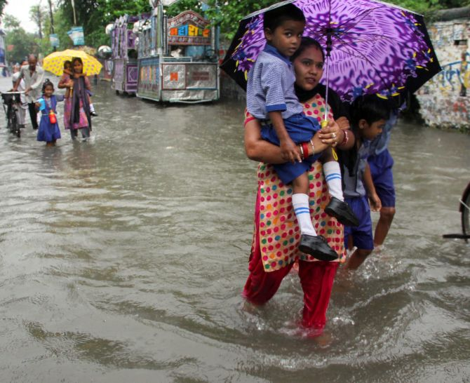 Image Pedestrians Try To Cross A Flooded Road During Rainfall In Meerut Meerut Has Already Received 23 Cm Of Rain P Ograph Pti P O