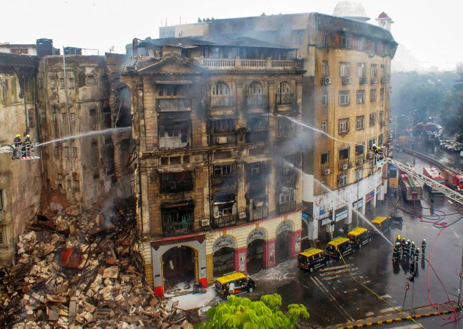 India News - Latest World & Political News - Current News Headlines in India - Part of building collapses in Mumbai after massive fire, 2 firemen injured