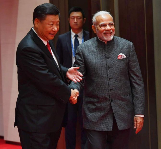 Prime Minister Narendra D Modi and China's Supreme Leader Xi Jinping at their meeting in Qingdao, China, June 9, 2018. Photograph: Press Information Bureau