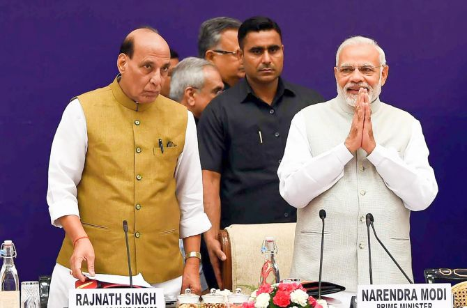 Prime Minister Narendra D Modi, right, with Home Minister Rajnath Singh at the NITI Aayog governing council meeting in New Delhi June 17, 2018. Photograph: PTI Photo