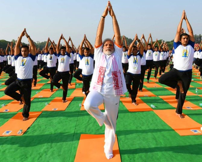 Modi practises yoga in Dehradun on World Yoga Day 2018