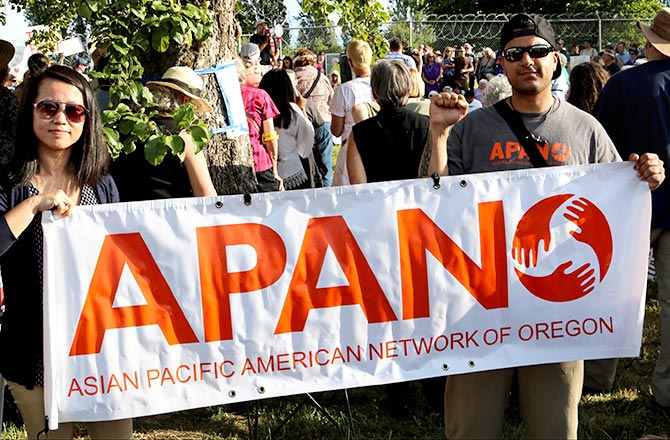 Chi Nguyen, interim Executive Director, Asian Pacific American Network of Oregon, left, and Jai Singh, field organiser, APANO, at the vigil outside the prison in Sheridan, Oregon, June 18, 2018.