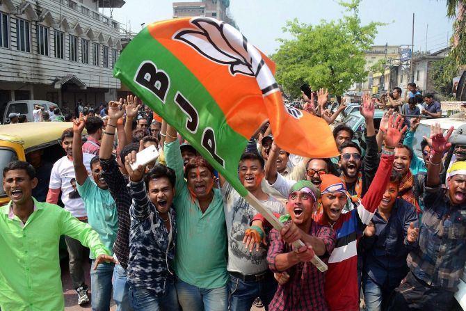 BJP supporters celebrate the party's victory in Agartala, March 3, 2018. Photograph: PTI Photo