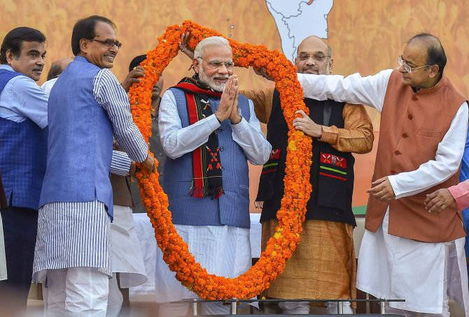 Narendra D Modi, with Shivraj Chauhan, Nitin Gadkari, Amit A Shah and Arun Jaitley celebrate the Bharatiya Janata Party victories in the north east, March 3, 2018. Photgraph: PTI Photo