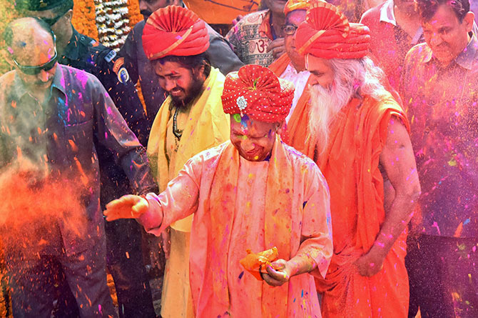 Uttar Pradesh Chief Minister Adityanath smeared with colour during Holi celebrations in Gorakhpur, March 2, 2018. Photograph: PTI Photo