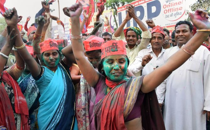 Samajwadi Party workers rejoice after the party shocked the BJP in the Lok Sabha by-elections in Gorakhpur and Phulpur. Photograph: PTI Photo