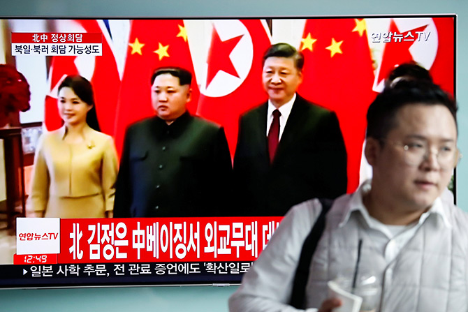 Seoul, March 28, 2018: South Korean television broadcasts a report on North Korean leader Kim Jong-un's meeting with China's supreme leader Xi Jinping in Beijing. Photograph: Kim Hong-Ji/Reuters