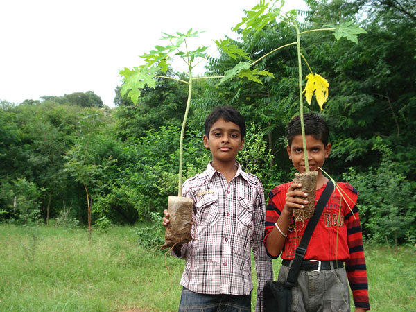 Local children planting saplings