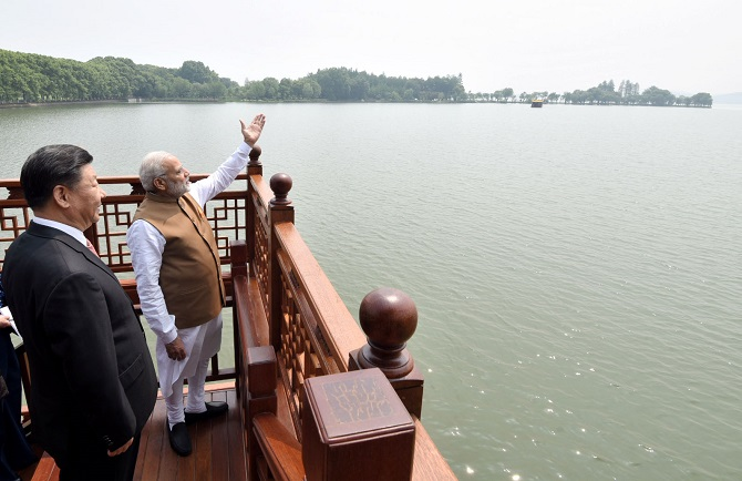 Prime Minister Narendra D Modi and China's Supreme Leader Xi Jinping on a house boat, in Wuhan's East Lake, China, April 28, 2018. Photograph: Press Information Bureau