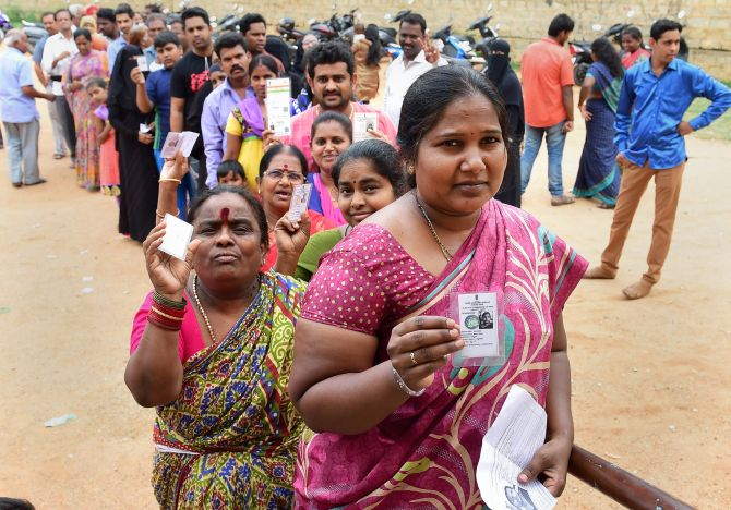 People queue up to cast their ballot for the Karnataka assembly election in Bengaluru, May 12, 2018. Photograph: Shailendra Bhojak/PTI Photo