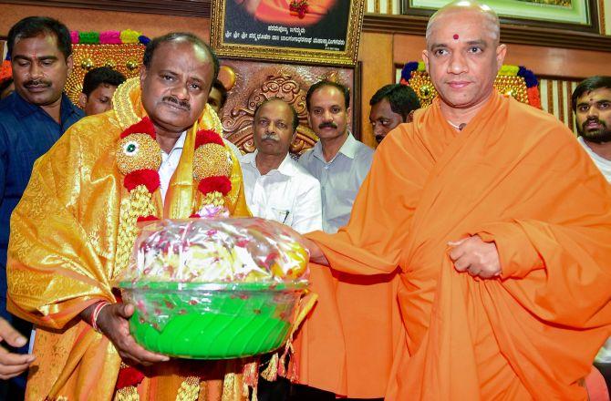 H D Kumaraswamy with Srisri Nirmalanandanatha Swamiji of the Adichunchungiri Mutt in Bengaluru. Photograph: PTI Photo