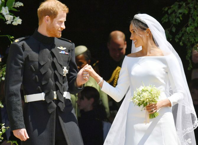 Markle Sparkles! Meghan stuns in Givenchy gown - Rediff.com India News