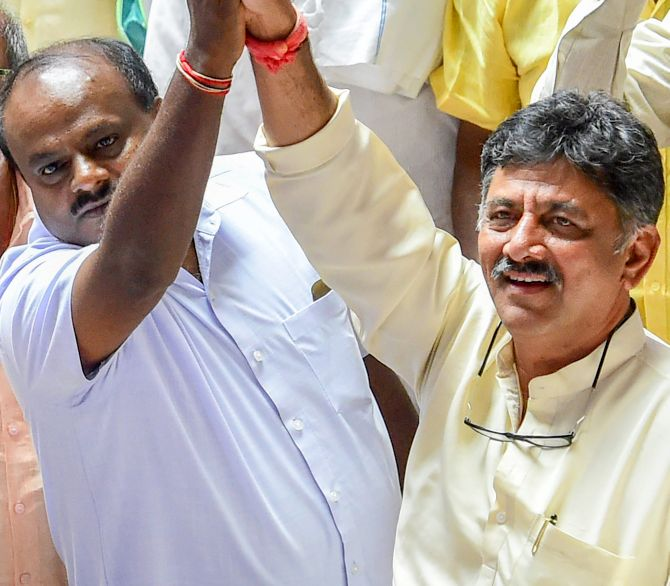 Janata Dal-Secular leader H D Kumaraswamy, left, and Congress leader D K Shivakumar celebrate after B S Yeddyurappa announced his resignation before the floor test, at the Vidhana Soudha, Bengaluru, May 19, 2018. Photograph: Shailendra Bhojak/PTI Photo