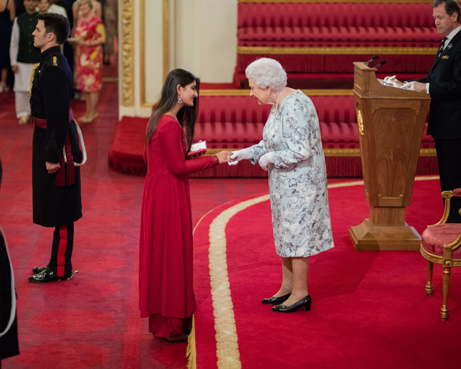 Suhani receives the Queen's Young Leader Award from Queen Elizabeth II at Buckingham Palace last year.