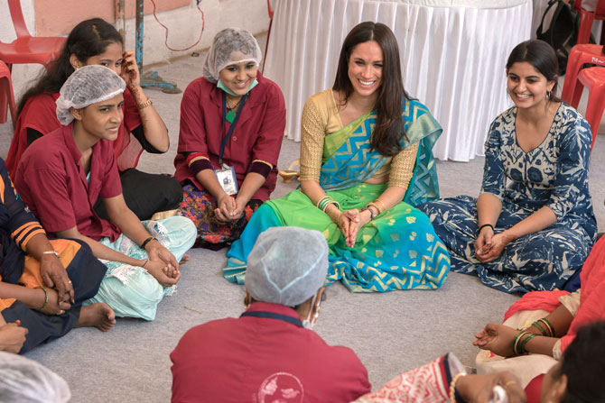 Meghan Markle interacts with the staff during her visit to the Myna Mahila Foundation last year