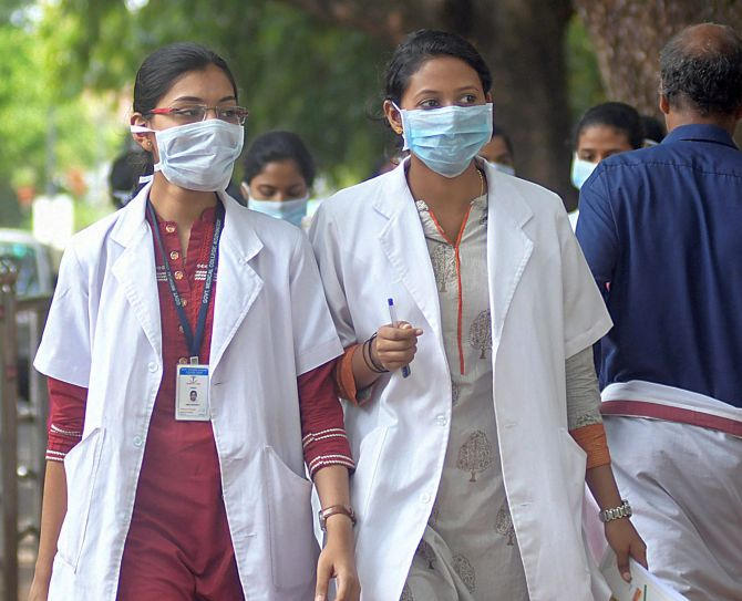 Doctors wear safety masks as a precaution after the outbreak of 'Nipah' virus, at a hospital in Kozhikode
